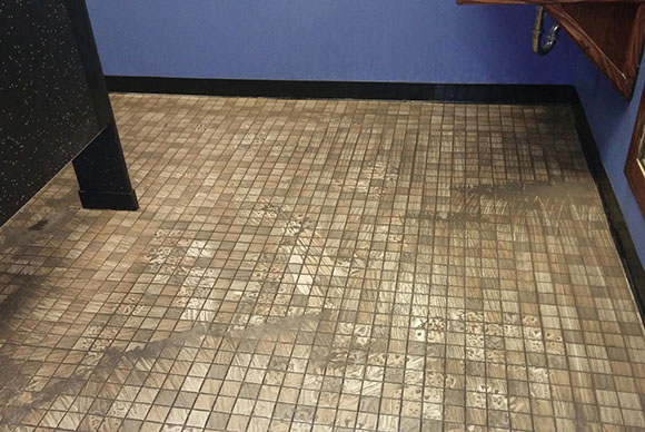 Cleaning dirty tile and grout.