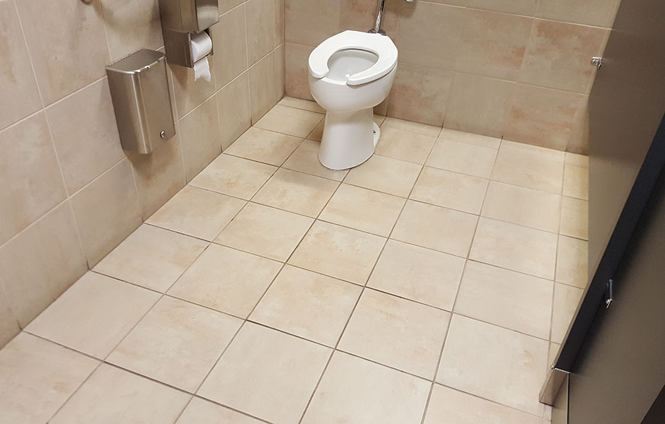 Dirty bathroom grout and floor